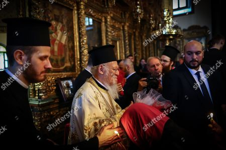 Stock Photo of Ecumenical Patriarch and Archbishop of Constantinople Bartholomew I (C), a spiritual leader of the Orthodox Christian around the world, attends the Easter ceremony at St George Church in Istanbul, Turkey, 28 April 2019. Orthodox Christian believers mark the Holy Week of Easter in celebration of the crucifixion and resurrection of Jesus Christ. The Eastern Orthodox world celebrates Easter Day according to the old Julian calendar.