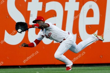 Philadelphia Phillies center fielder Andrew McCutchen catches a line-out by Miami Marlins' Isaac Galloway during the fourth inning of a baseball game, in Philadelphia