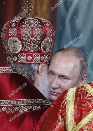 Patriarch Kirill (L) of Moscow and All Russia kisses Russian President Vladimir Putin (R) as they congratulate each other during the Orthodox Easter holiday service at the Christ the Savior Cathedral in Moscow, Russia, 28 April 2019.