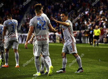 Harrison, New Jersey, U.S. - New York Red Bulls forward Brian White (42) celebrate with defender Connor Lade (5) after scoring a goal in action during a MLS match between the FC Cincinnati and the New York Red Bulls at Red Bulls Area in Harrison, New Jersey