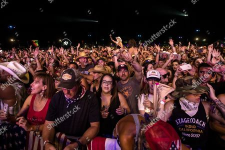 The audience cheers as US singer Sam Hunt (unseen) performs on stage during the Stagecoach Festival in Indio near Palm Spring, California, USA, 27 April 2019. The festival runs from 26 to 28 April.