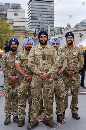Members of the British Armed Forces Sikh Association pose for a photo during the festival of Vaisakhi in Trafalgar Square, hosted by the Mayor of London.