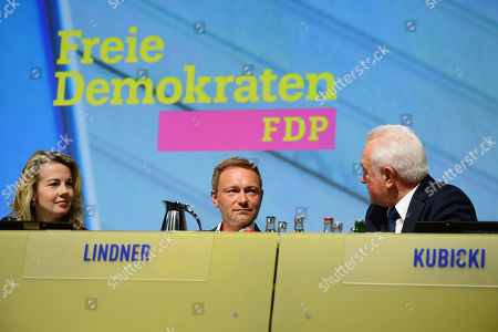 (L-R) Free Democratic Party (FDP) General Secretary Linda Teuteberg, chairman and faction chairman in the German parliament Bundestag Christian Lindner and deputy chairman and president of the German Parliament Wolfgang Kubicki talk during the third day of the party convention of the Free Democratic Party (FDP) at the Station Berlin, in Berlin, Germany, 28 April 2019. The FDP party convention runs from 26 to 28 April.