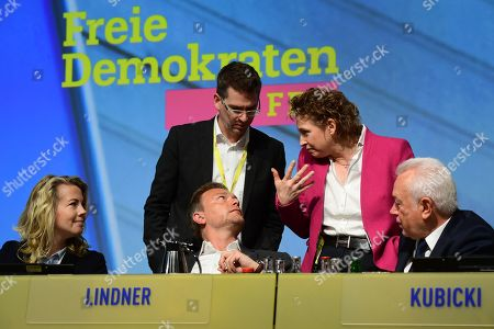 (L-R) Free Democratic Party (FDP) General Secretary Linda Teuteberg, chairman and faction chairman in the German parliament Bundestag Christian Lindner (front), federal party manager Marco Mendorf, deputy chairwoman and top candidate for the European Parliament elections Nicola Beer and deputy chairman and president of the German Parliament Wolfgang Kubicki talk during the third day of the party convention of the Free Democratic Party (FDP) at the Station Berlin, in Berlin, Germany, 28 April 2019. The FDP party convention runs from 26 to 28 April.
