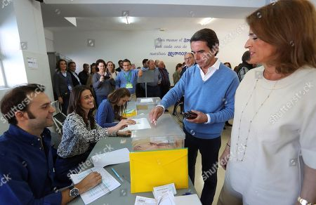 Stock Image of Former Prime Minister Jose Maria Aznar (2-R) casts his vote next to his wife Ana Botella (R) during general elections at a polling station in Madrid, Spain, 28 April 2019. Nearly 36.9 million people are called to vote in the third general elections in four years with the results of polls showing Spanish Prime Minister, Pedro Sanchez, as the winer of the most votes but not enough to get majority to form Government on his own.