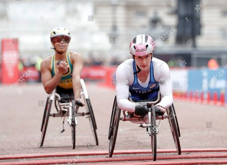 Tatyana McFadden of the United States wins second place followed by third place winner Australia's Madison de Rozario in the women's wheelchair race of the 39th London Marathon in London