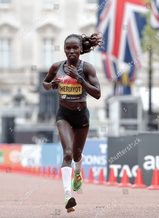 Kenya's Vivian Cheruiyot approaches the finish line to win second place in the women's race at the 39th London Marathon in London