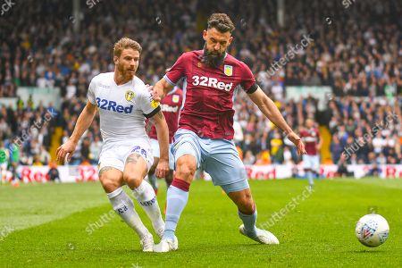 Gaetano Berardi of Leeds United (28) and Mile Jedinak of Aston Villa (15) in action during the EFL Sky Bet Championship match between Leeds United and Aston Villa at Elland Road, Leeds