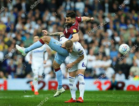 Mile Jedinak of Aston Villa and Liam Cooper of Leeds United