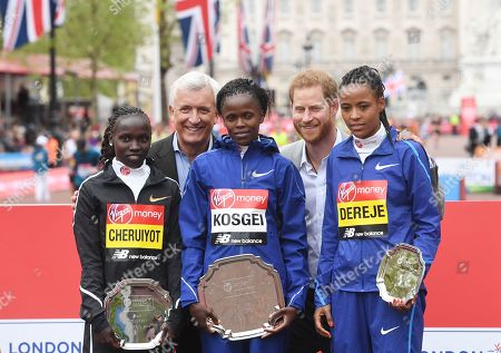Second placed, Kenya's Vivian Cheruiyot (L), winner, Kenya's Brigid Kosgei (C) and third placed, Ethiopia's Roza Dereje (R) pose with Britain's Prince Harry (2-R), the Duke of Sussex at the medal ceremony for the elite women's race during the 2019 Virgin Money London Marathon in London, Britain, 28 April 2019.