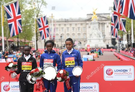 Second placed, Kenya's Vivian Cheruiyot (L), winner, Kenya's Brigid Kosgei (C) and third placed, Ethiopia's Roza Dereje (R) pose at the medal ceremony for the elite women's race during the 2019 Virgin Money London Marathon in London, Britain, 28 April 2019.