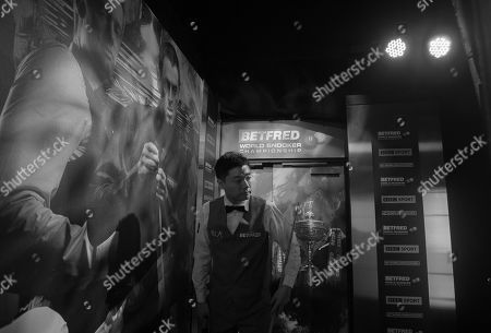 Ding Junhui of China waits backstage before his second round match