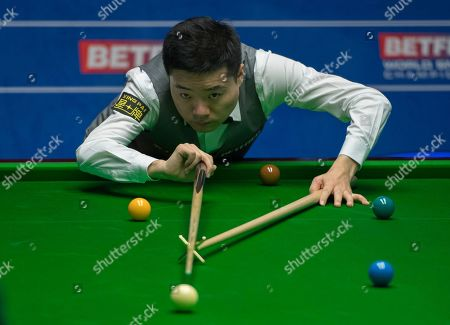 Ding Junhui of China at the table during his second round match