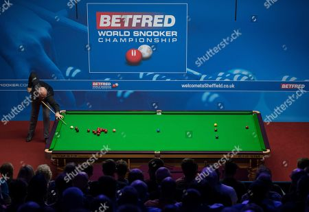 Stuart Bingham of England at the table during his second round match