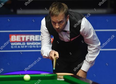 Ali Carter of England at the table during his second round match