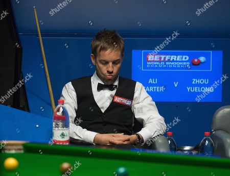 Ali Carter of England sits in his chair during his second round match