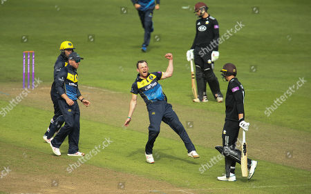 Graham Wagg of Glamorgan celebrates after taking the wicket of Jamie Smith of Surrey