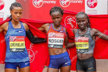 Stock Image of Roza Dereje (Ethiopia) third Place, Brigid Kosgei (Kenya) first place, Vivian Cheruiyot (Kenya) second place, Women's Elite race, during the Virgin Money 2019 London Marathon, London