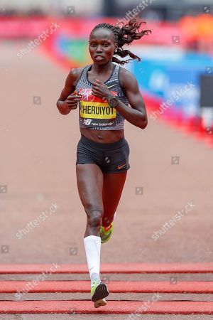 Vivian Cheruiyot (Kenya), runner-up, Women's Elite race, during the Virgin Money 2019 London Marathon, London