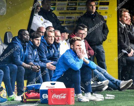 Schalke coach Huub Stevens, right, Gerald Asamoah, left, and Mike Bueskens follow the match during the German Bundesliga soccer match between Borussia Dortmund and FC Schalke 04 in Dortmund, Germany