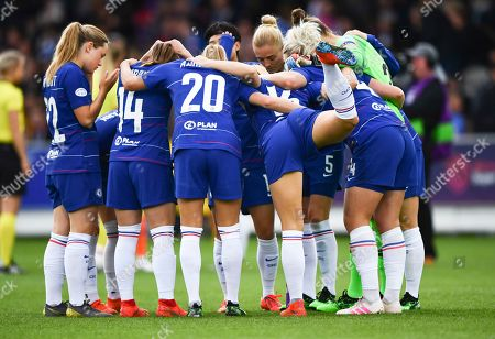 Magdalena Ericsson of Chelsea Ladies raises her leg as her team huddles before kick off