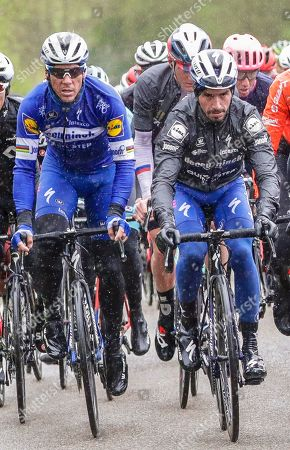 Belgian rider Philippe Gilbert (L) of the Deceuninck-Quick Step team and his French teammate Julian Alaphilippe (R) in action during the Liege Bastogne Liege one day classic cycling race near Houffalize, Belgium, 28 April 2019.