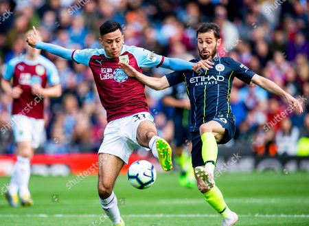 Burnley's Dwight McNeil (L) in action against Manchester City's Bernardo Silva (R) during the English Premier League soccer match between Burnley FC and Manchester City at the Turf Moor in Burnley, Britain, 28 April 2019.
