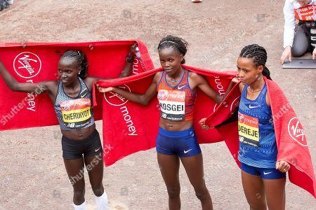 Vivian Cheruiyot (Kenya) Brigid Kosgei (Kenya) and Roza Dereje (Ethiopia)