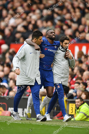 Antonio Rudiger of Chelsea leaves the field with an injury.