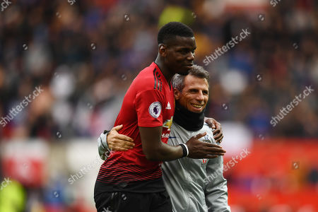 Paul Pogba of Manchester United hugs Gianfranco Zola of Chelsea.
