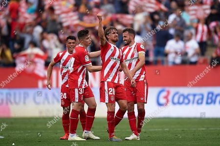 Marc Muniesa of Girona FC celebrates the victory with his teammates Valery Fernandez, Pedro Porro and Cristhian Stuani after finishing the match