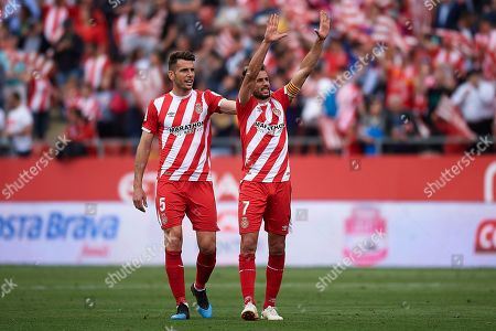 Stock Photo of Cristhian Stuani of Girona FC celebrates the victory with his teammate Pedro Alcalá after finishing the match