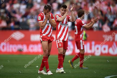 Stock Image of Cristhian Stuani of Girona FC celebrates the victory with his teammate Valery Fernandez after finishing the match