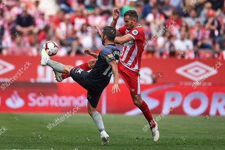 Jesus Navas of Sevilla FC and Cristhian Stuani of Girona FC