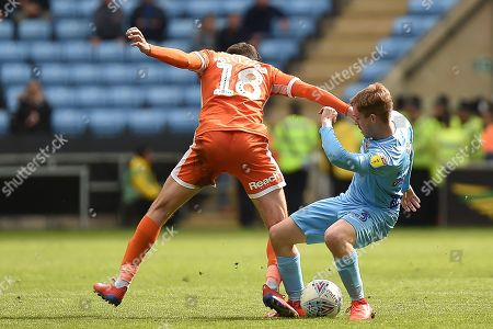 Coventry City midfielder (on loan from Derby County Luke Thomas (23) battles for possession  with Shrewsbury Town midfielder Alex Gilliead (18) during the EFL Sky Bet League 1 match between Coventry City and Shrewsbury Town at the Ricoh Arena, Coventry
