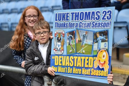 Two young Coventry City fans with their home made banner bidding farewell to Coventry City midfielder (on loan from Derby County Luke Thomas (23) during the EFL Sky Bet League 1 match between Coventry City and Shrewsbury Town at the Ricoh Arena, Coventry