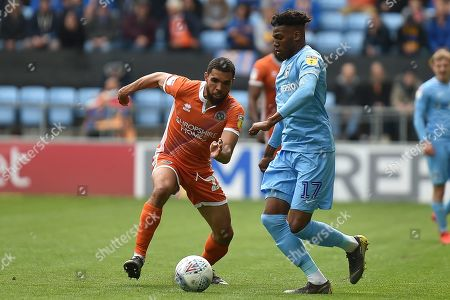 Shrewsbury Town defender Scott Golbourne (23) battles for possession  with Coventry City defender (on loan from Chelsea) Dujon Sterling (17) during the EFL Sky Bet League 1 match between Coventry City and Shrewsbury Town at the Ricoh Arena, Coventry