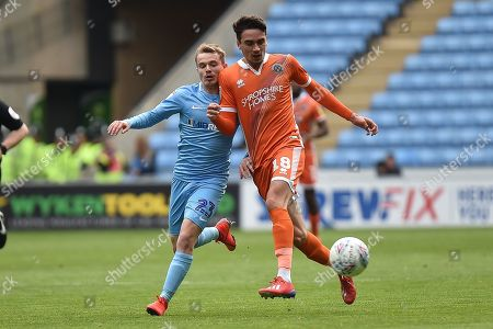 Stock Picture of Shrewsbury Town midfielder Alex Gilliead (18) looks to release the ball  under pressure from Coventry City midfielder (on loan from Derby County Luke Thomas (23) during the EFL Sky Bet League 1 match between Coventry City and Shrewsbury Town at the Ricoh Arena, Coventry