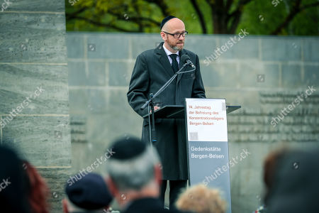 The secretary of state at the German Ministry of Defense, Peter Tauber, speaks during a memorial service at the concentration camp of Bergen-Belsen on the occasion of the 74th anniversary of its liberation in Bergen-Belsen, northern Germany, 28 April 2019. From 1943 until the liberation by British forces, about 52,000 inmates of Bergen-Belsen came to death due to the atrocious conditions of detention in the camp.