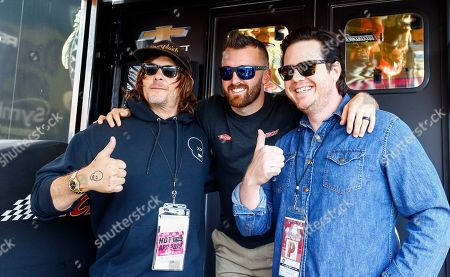"""Actors Norman Reedus, left, and Josh McDermitt, right, of """"The Walking Dead,"""" pose with NASCAR Cup Series driver Austin Dillon, center, before the Geico 500 at Talladega Superspeedway, in Talladega, Ala"""
