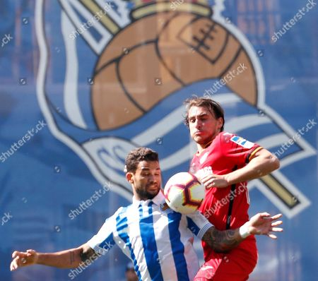 Real Sociedad's Brazilian Willian Jose (L) duels for the ball with Getafe CF's French Mathieu Flamini (R) during their Spanish LaLiga Primera Division soccer match played at the Anoeta stadium in San Sebastian, Spain, 28 April 2019.