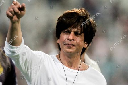 Shah Rukh Khan, Bollywood actor and Kolkata Knight Riders co-owner gestures the people in the stadium after his team won the match against Mumbai Indians at the VIVO IPL cricket T20 in Kolkata, India