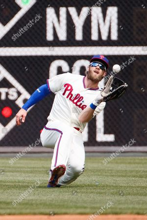 Philadelphia Phillies right fielder Bryce Harper (3) slides to make the catch during the MLB game between the Miami Marlins and Philadelphia Phillies at Citizens Bank Park in Philadelphia, Pennsylvania