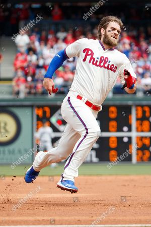 Philadelphia Phillies' Bryce Harper (3) runs to third on his way home to score a run during the MLB game between the Miami Marlins and Philadelphia Phillies at Citizens Bank Park in Philadelphia, Pennsylvania