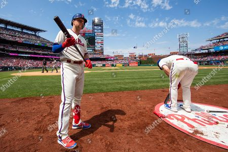 Philadelphia Phillies' Rhys Hoskins (17) looks on as Bryce Harper (3) gets ready for his at bat during the MLB game between the Miami Marlins and Philadelphia Phillies at Citizens Bank Park in Philadelphia, Pennsylvania
