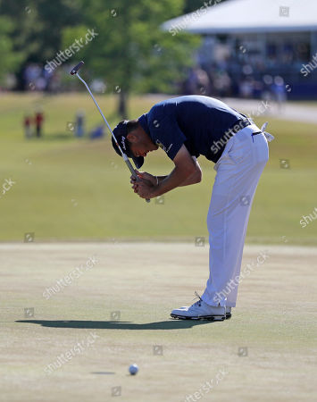 Ryan Palmer reacts after missing a putt on the 18th green during the final round of the PGA Zurich Classic golf tournament at TPC Louisiana in Avondale, La