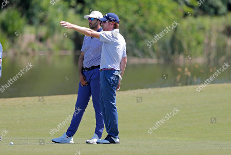 Stock Photo of Cameron Triangle and teammate Roberto Castro discuss their shot on the 18th fairway during the final round of the PGA Zurich Classic golf tournament at TPC Louisiana in Avondale, La