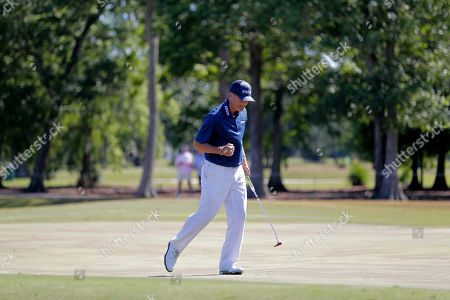 Ryan Palmer pumps his fist after he made a birdie putt on the 14th green during the final round of the PGA Zurich Classic golf tournament at TPC Louisiana in Avondale, La., . Palmer and teammate Jon Rahm won the tournament -26 by three strokes