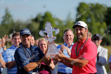 Ryan Palmer, left, and Joh Rahm, hold their tournament trophy after winning the PGA Zurich Classic golf tournament at TPC Louisiana in Avondale, La