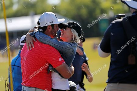 Jon Rahm embraces his girlfriend Kelley Cahill after he and teammate Ryan Palmer won the PGA Zurich Classic golf tournament at TPC Louisiana in Avondale, La